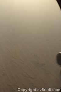 turning over the desert to line up with runway 30R