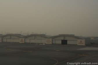 A few seconds before touchdown, that's the EK Engineering Centre's hangars