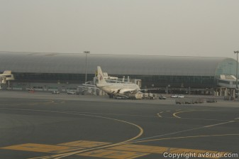 A Qatar Airways A320 parked at DXB's Terminal 1