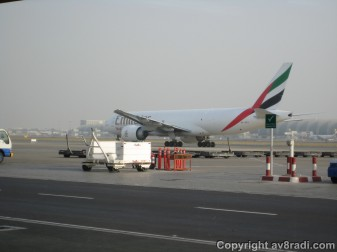 An EK Sky Cargo Boeing 777F taxies by