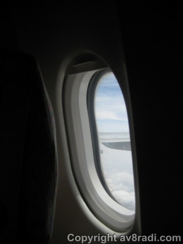 Wingview Airbus A330-200 (Emirates). Small Oval windows to withstand forces of pressurization