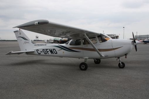 A Cessna 172, non-pressurized cabin, hence large windows