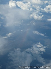 More monsoon clouds and a rainbow (it's rather faint)