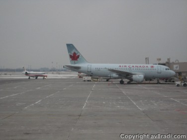 An American Airlines Eagle E-145 taxies to the gate at YOW