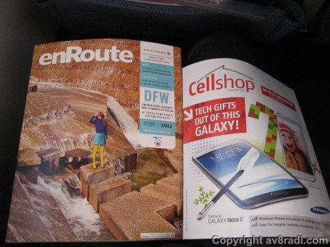 The inflight magazine - Enroute - and an ad leaflet