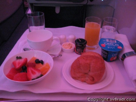 A selection of fruits and fresh croissant