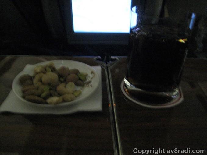 Drink (Coca-Cola) and nuts
