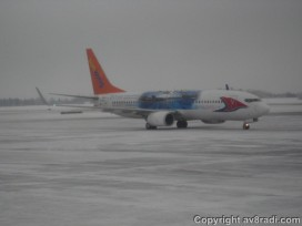 A Sunwing Boeing 737-800 taxies by