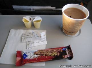 Complimentary drink (coffee) and snack (wafers)