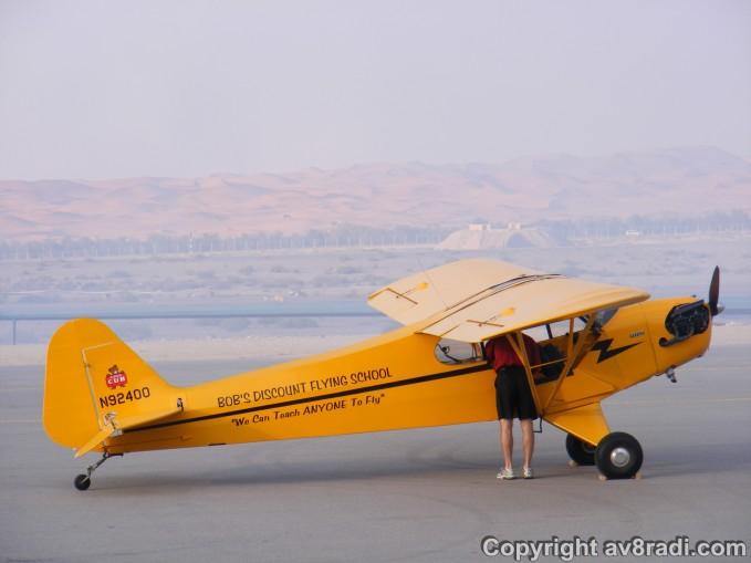 The Pilot prepares the aircraft as Skip Stewart performs